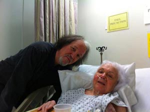 Andy cares for his elderly mother in the hospital