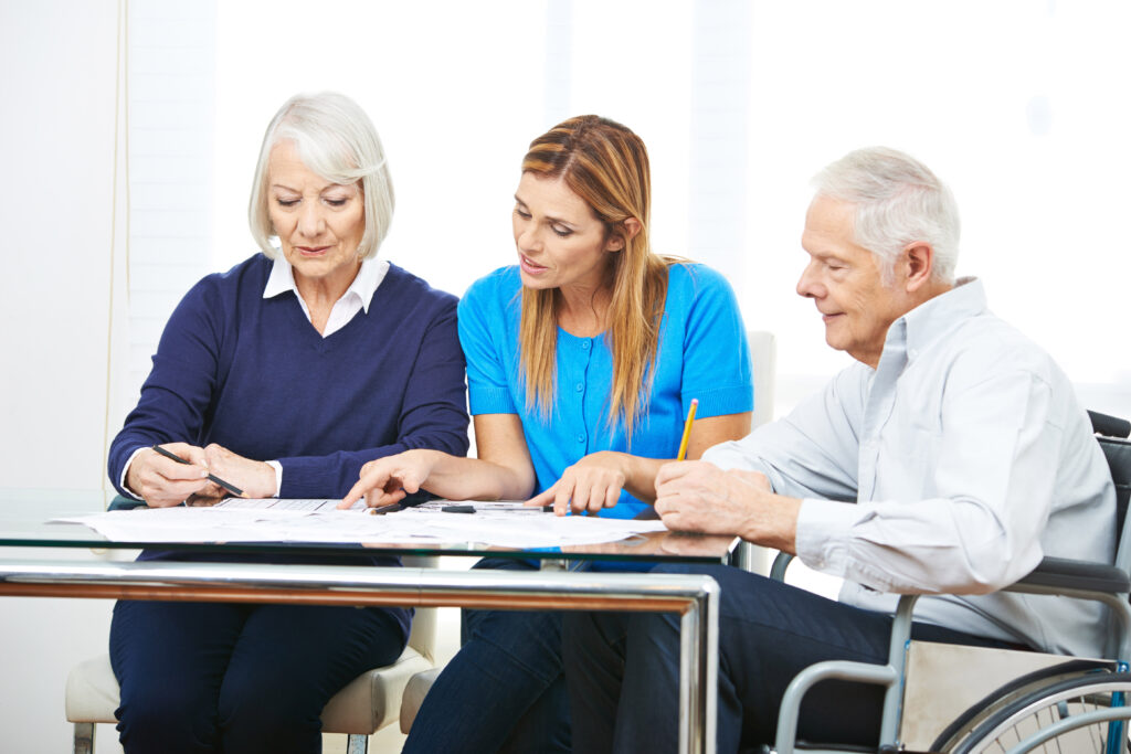 POP Family Coach meets with elderly couple to discuss their POP Family plan.